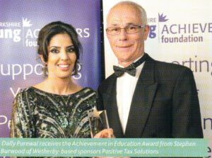 Dally Purewal receives the Achievement in Education Award from Stephen Burwood of Positive Tax Solutions LLP